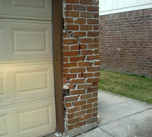 Damage Brick Garage Wall